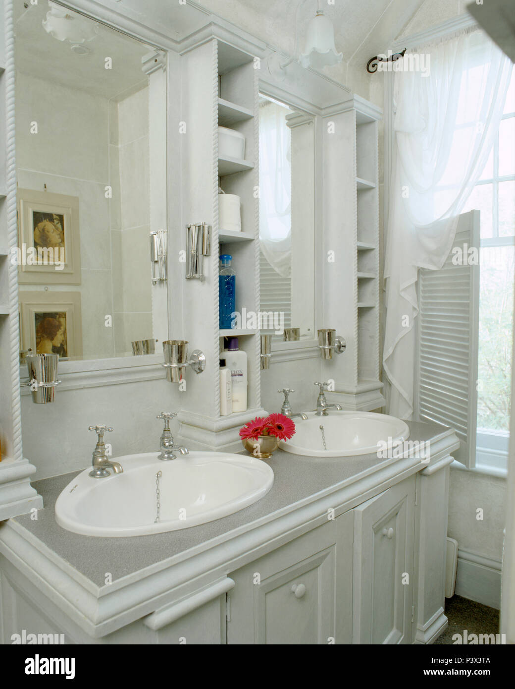 Storage Shelves And Mirrors Above Vanity Unit With Double