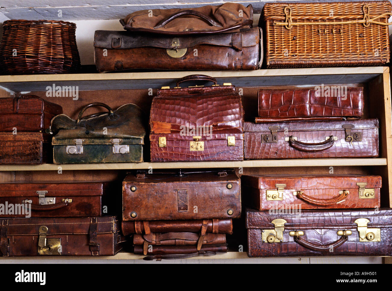 Shelves Of Battered Old Leather Suitcases Stock Photo