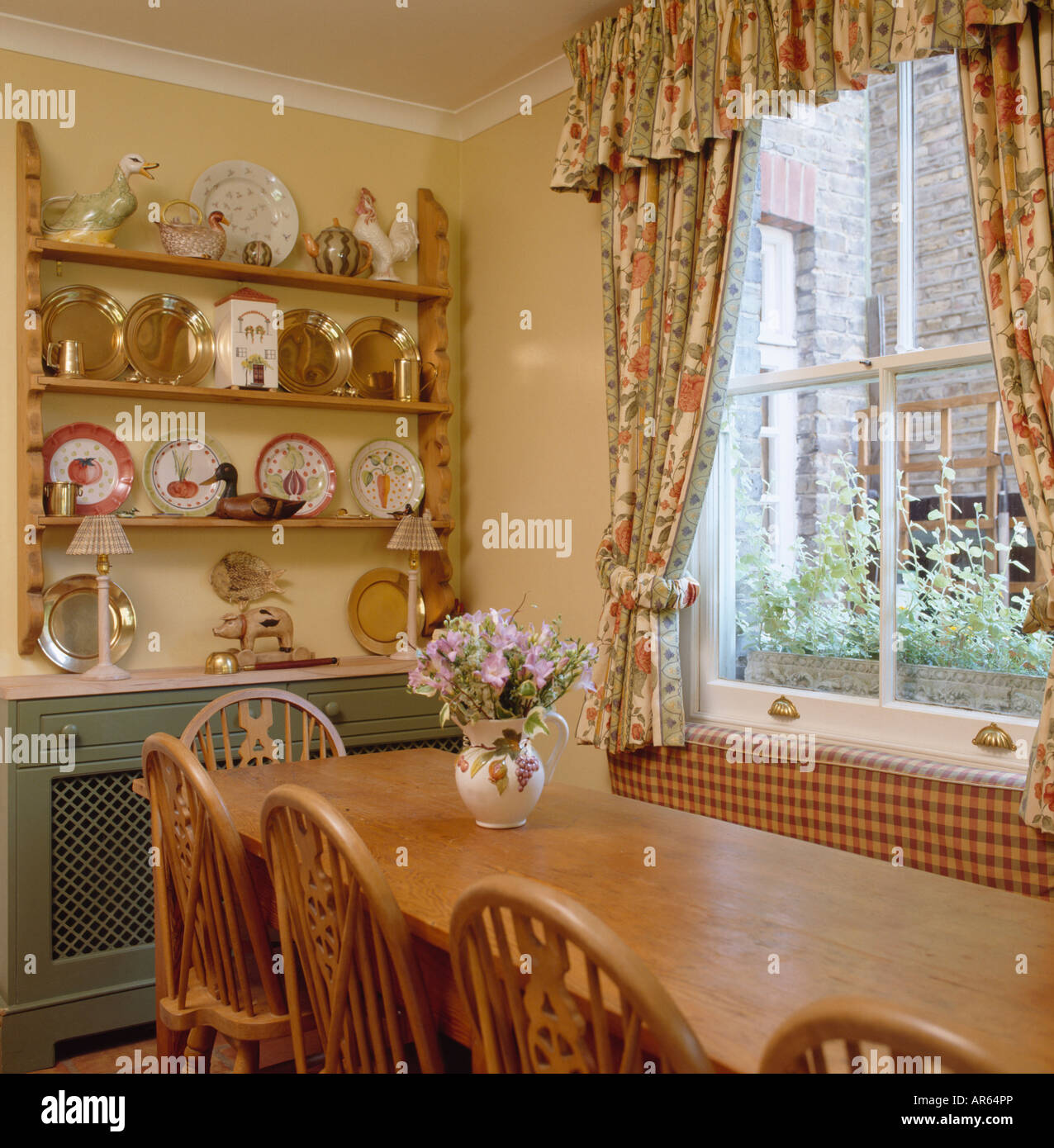 Pine Table And Plates On Pine Shelves In Dining Room With