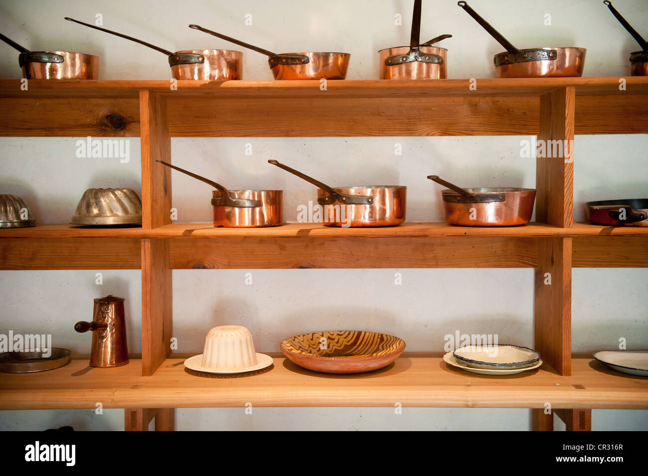 Shelves Of Copper Pots And Pans In A Kitchen On Thomas