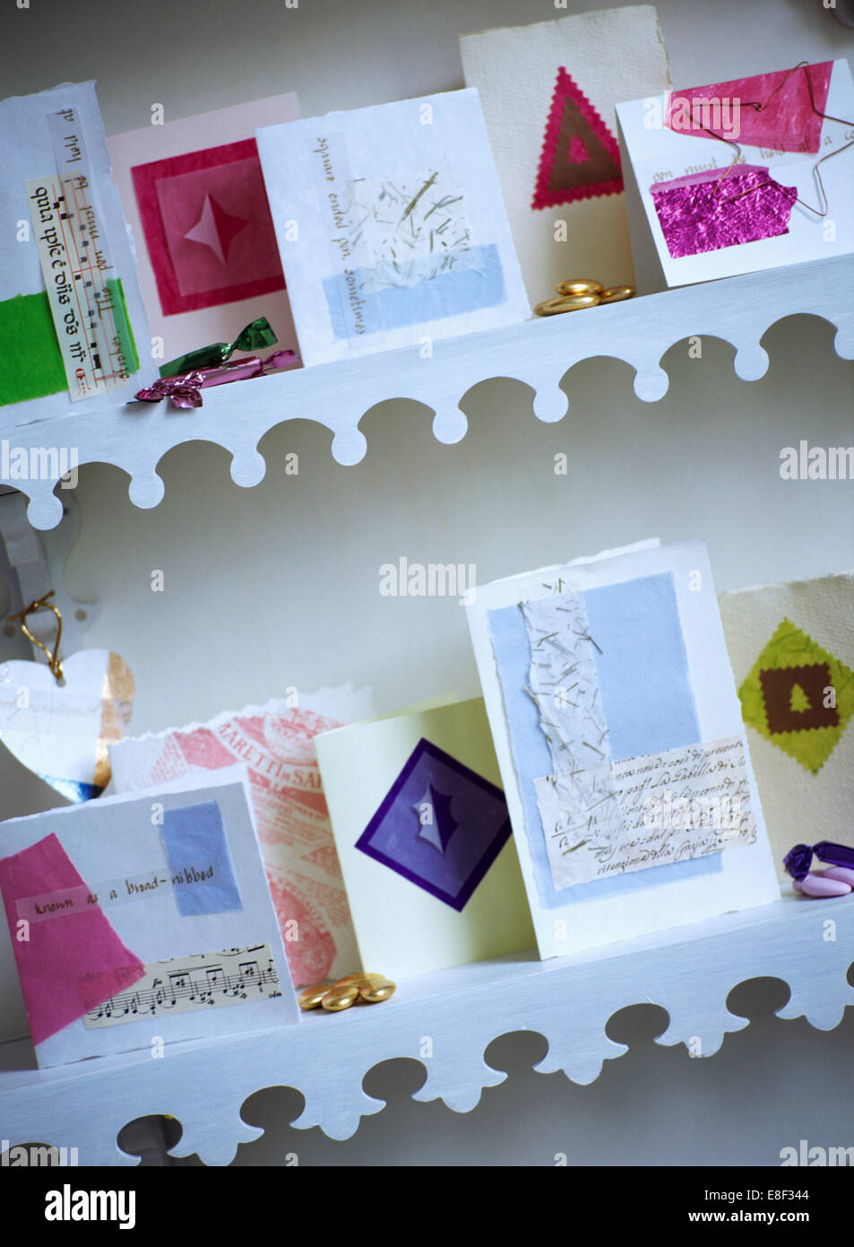 Close-up Of Hand Made Christmas Cards On Shelves With White