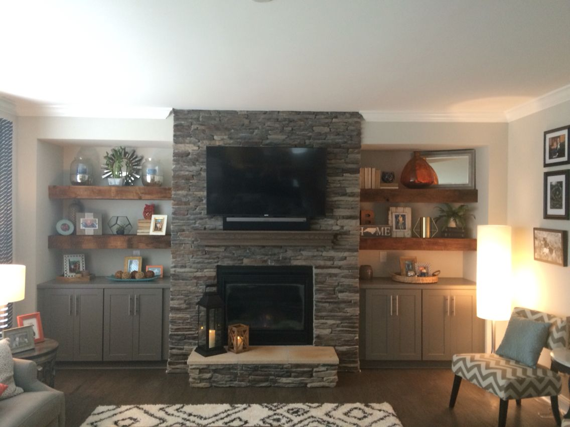 Our Beautiful Reclaimed Wood Floating Shelves Flanking Stone
