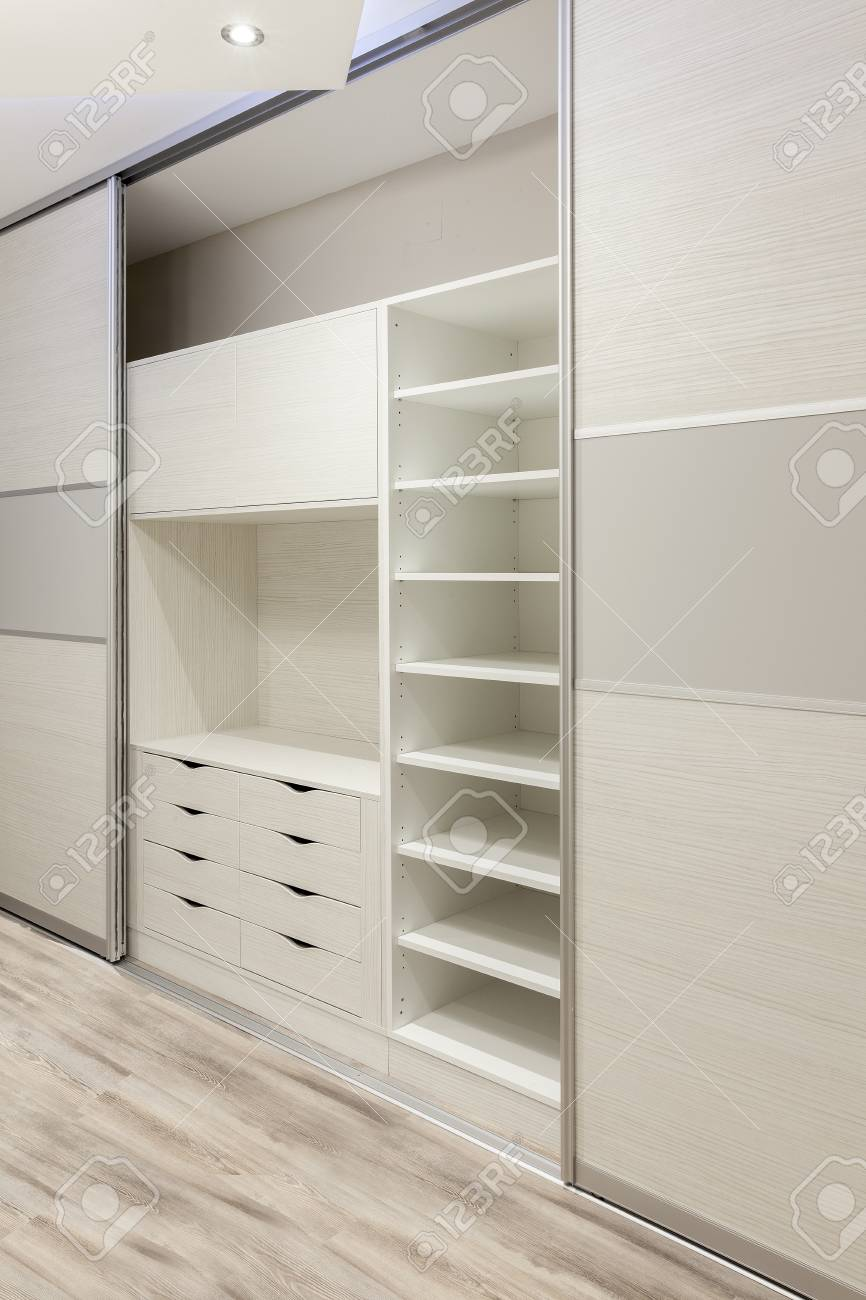 Wardrobe With Sliding Doors With Lots Of Shelves And Drawers