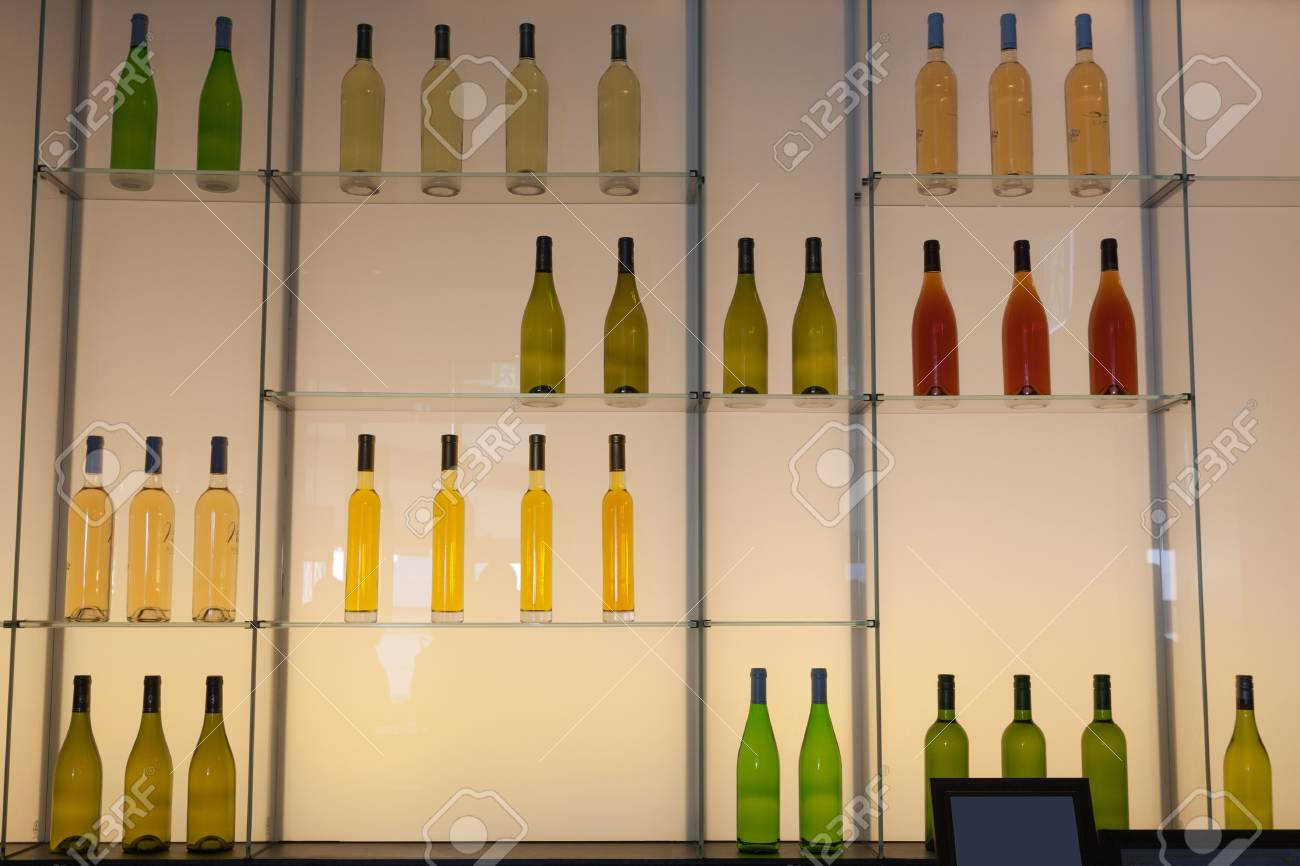 Shelves With Colorful Bottles Of Alcohol Drinks