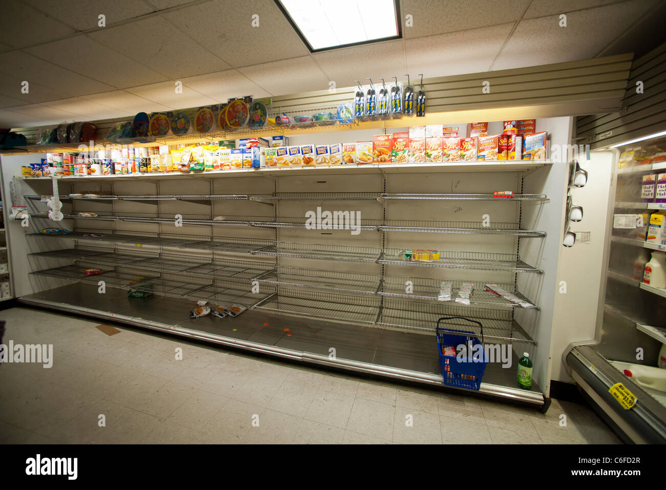 Shelves Stripped Bare Of Bread By Customers Stocking Up For