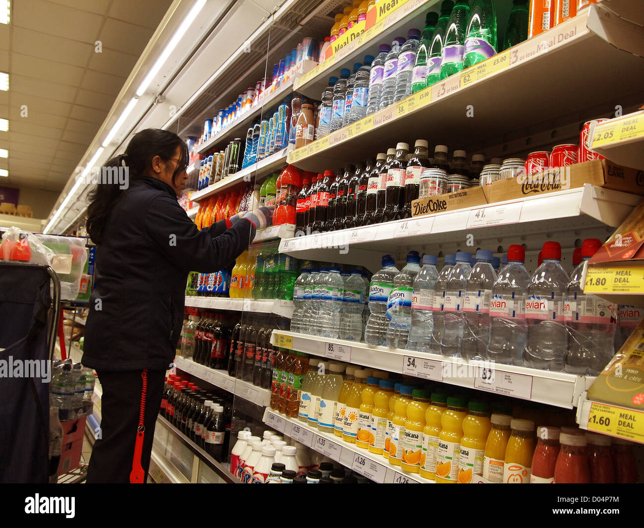 Staff Stacking Shelves In Tesco Stock Photo: 51736376 - Alamy