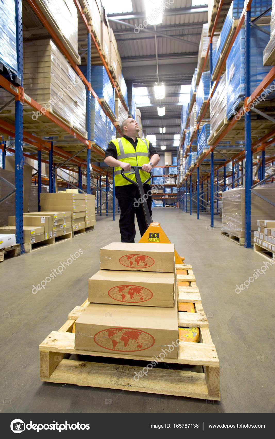 Warehouse Worker Boxes Pallet Truck Looking Shelves — Stock Photo