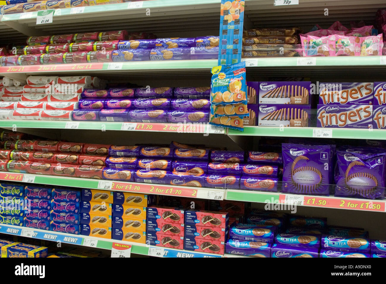 Chocolate Biscuits Stacked On Supermarket Shelves Stock Photo