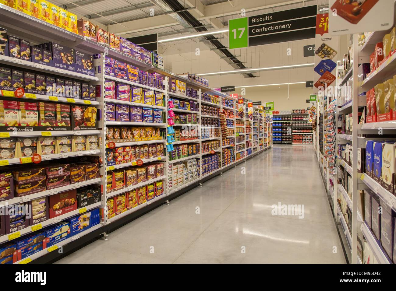 Biscuits And Confectionery On Full Shelves In An Asda Supermarket