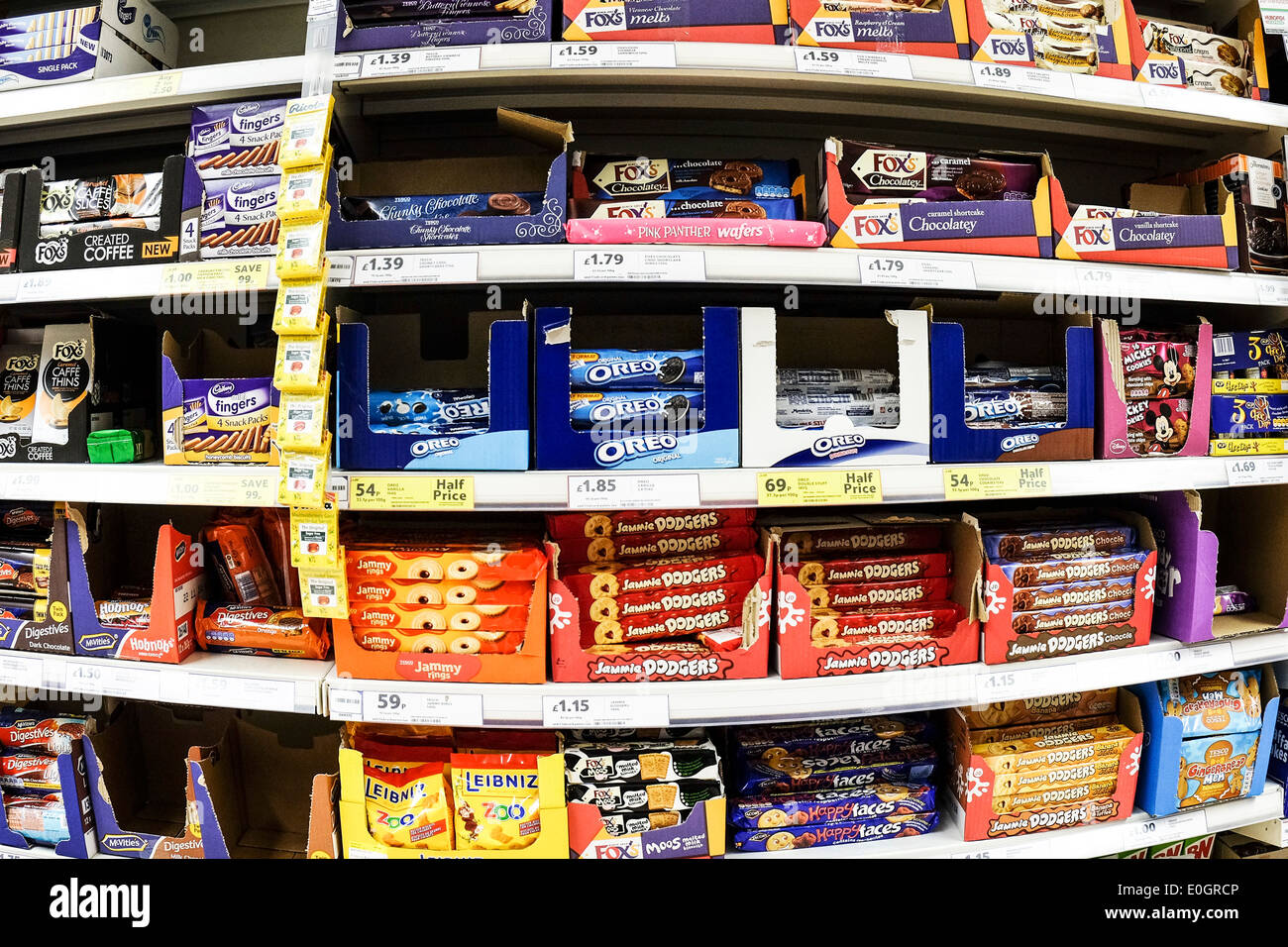 Shelves Of Packets Of Biscuits On Display In A Tesco Supermarket