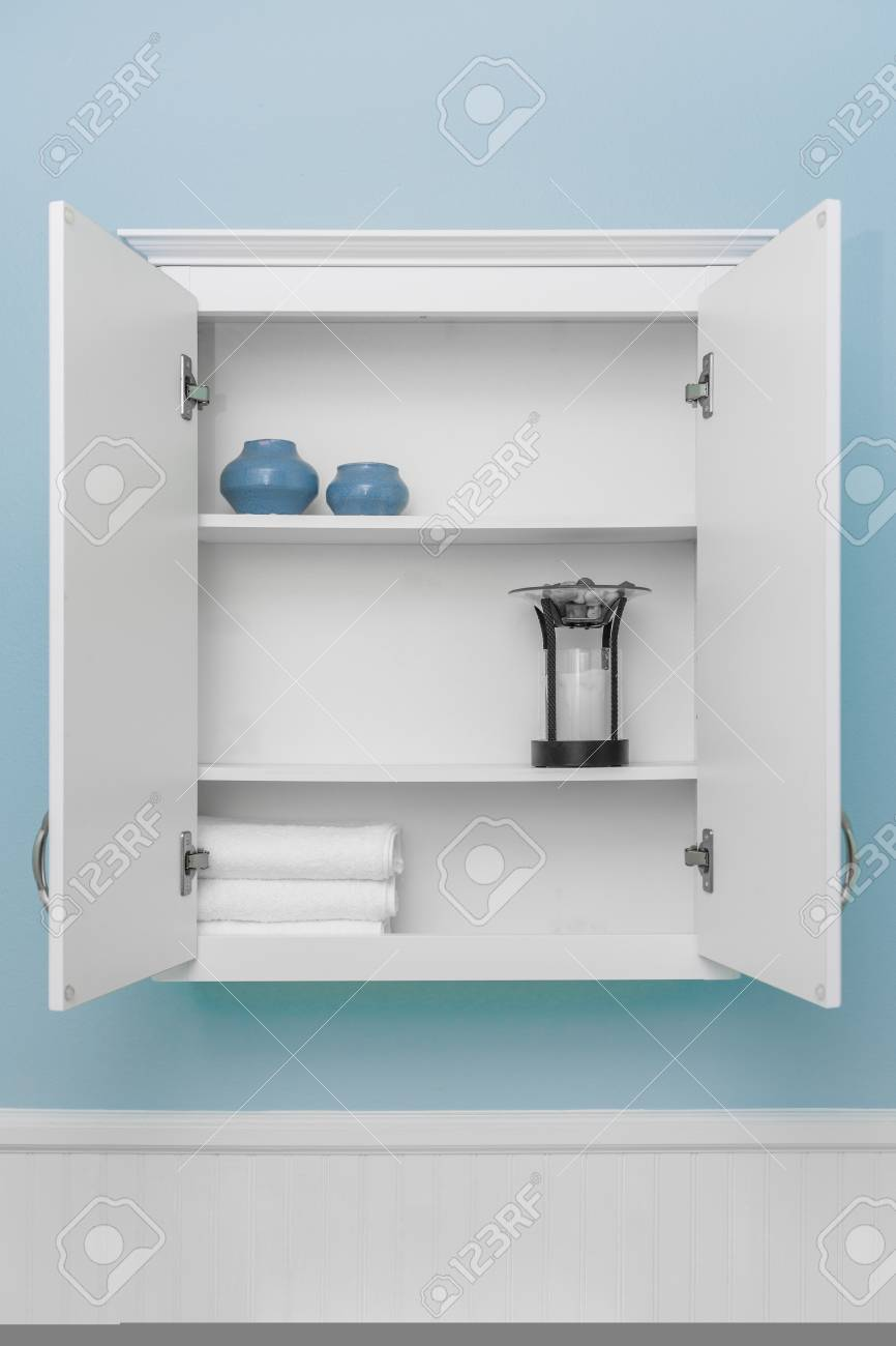 Stylish Home Decor On Shelves Of Clean White Cabinet, Empty Space