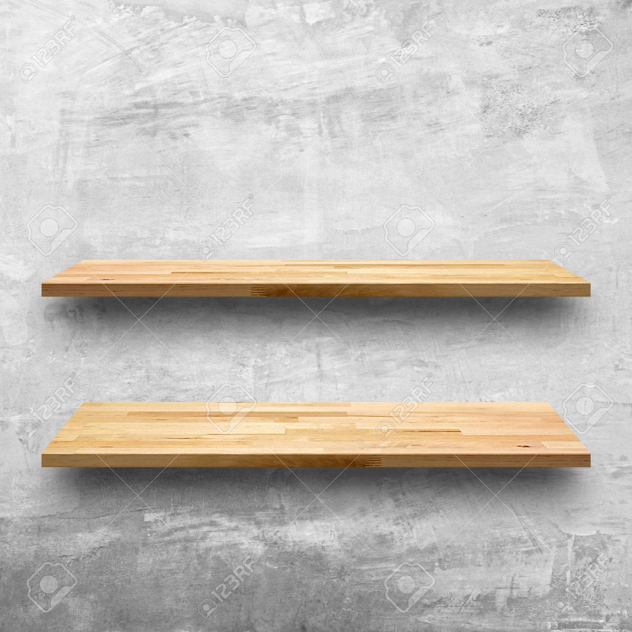 Empty Wooden Shelves On Concrete Wall Background
