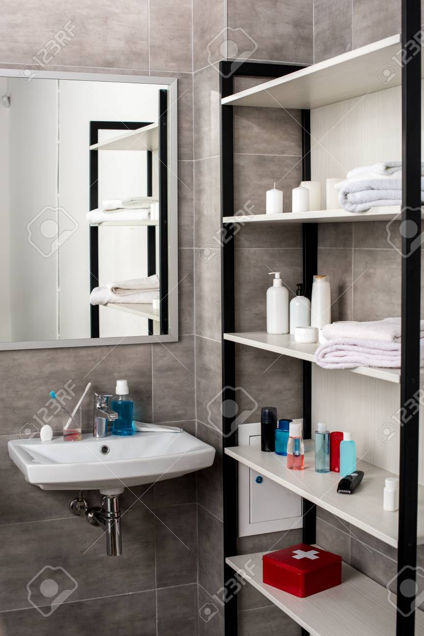 Interior Of Modern Bathroom With Sinks And Shelves With Beauty