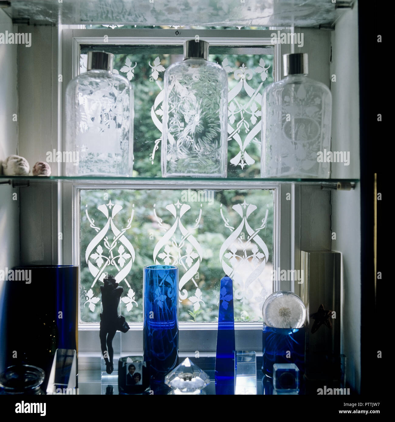 Collection Of Blue And Clear Glass On Window Shelves  Lord