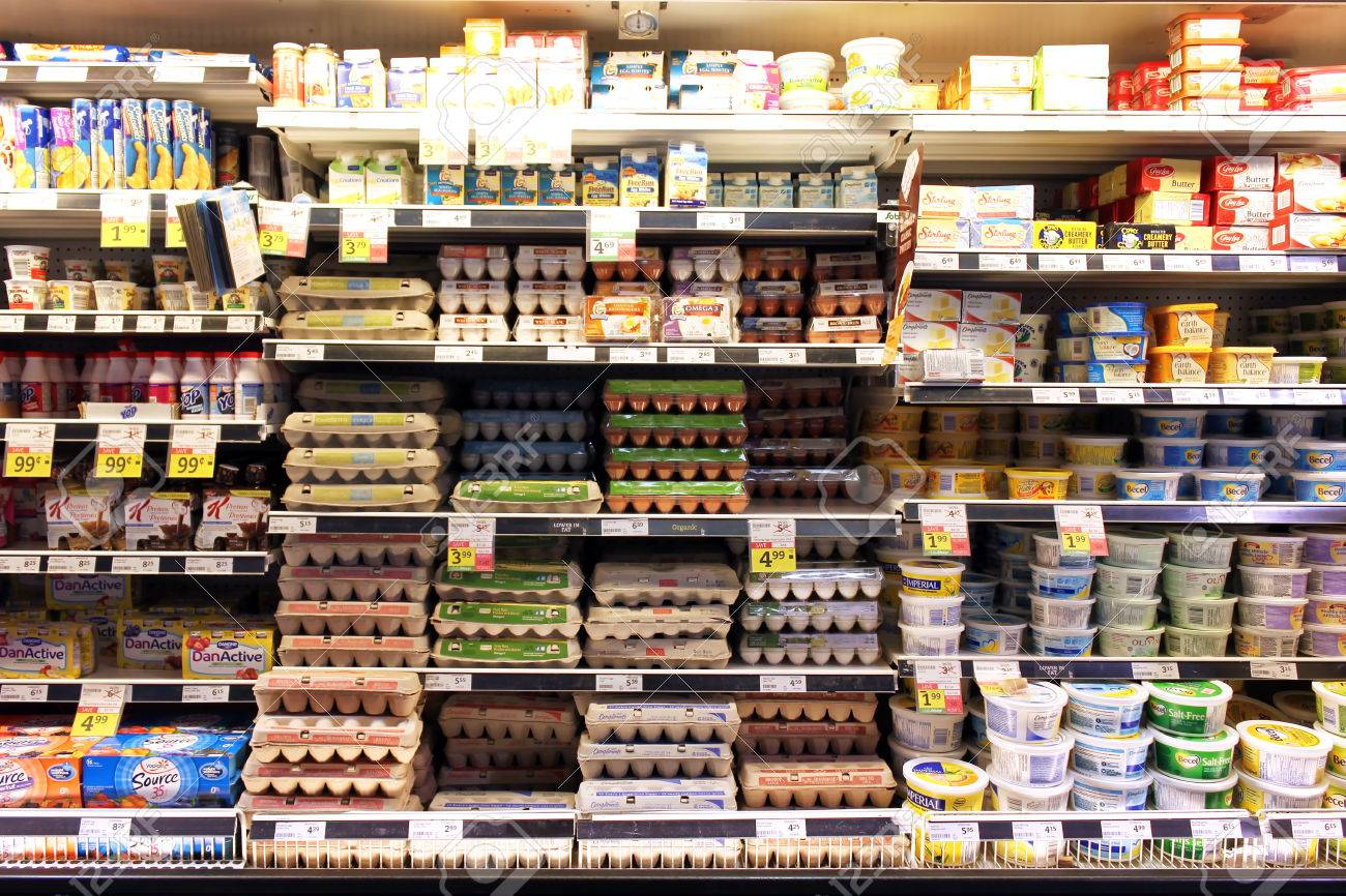 Eggs And Dairy Products On Shelves In A Supermarket Stock Photo
