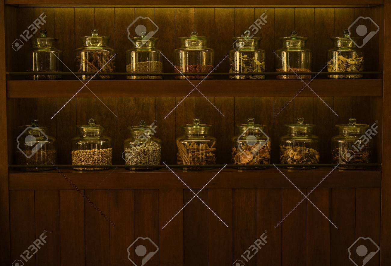 Arrangement Of Dry Food Products On Dark Wooden Shelves