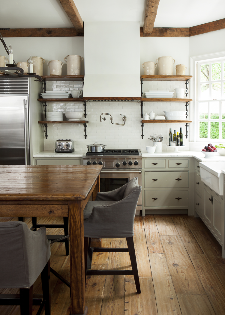 White Kitchen With Exposed Beams, Open Shelves, Farm Table