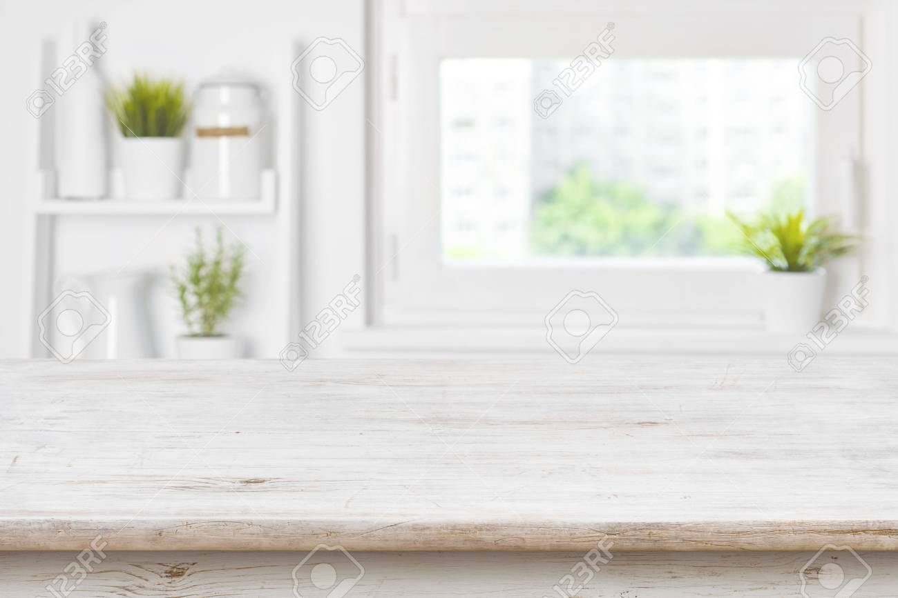 Empty Textured Wooden Table And Kitchen Window Shelves Blurred