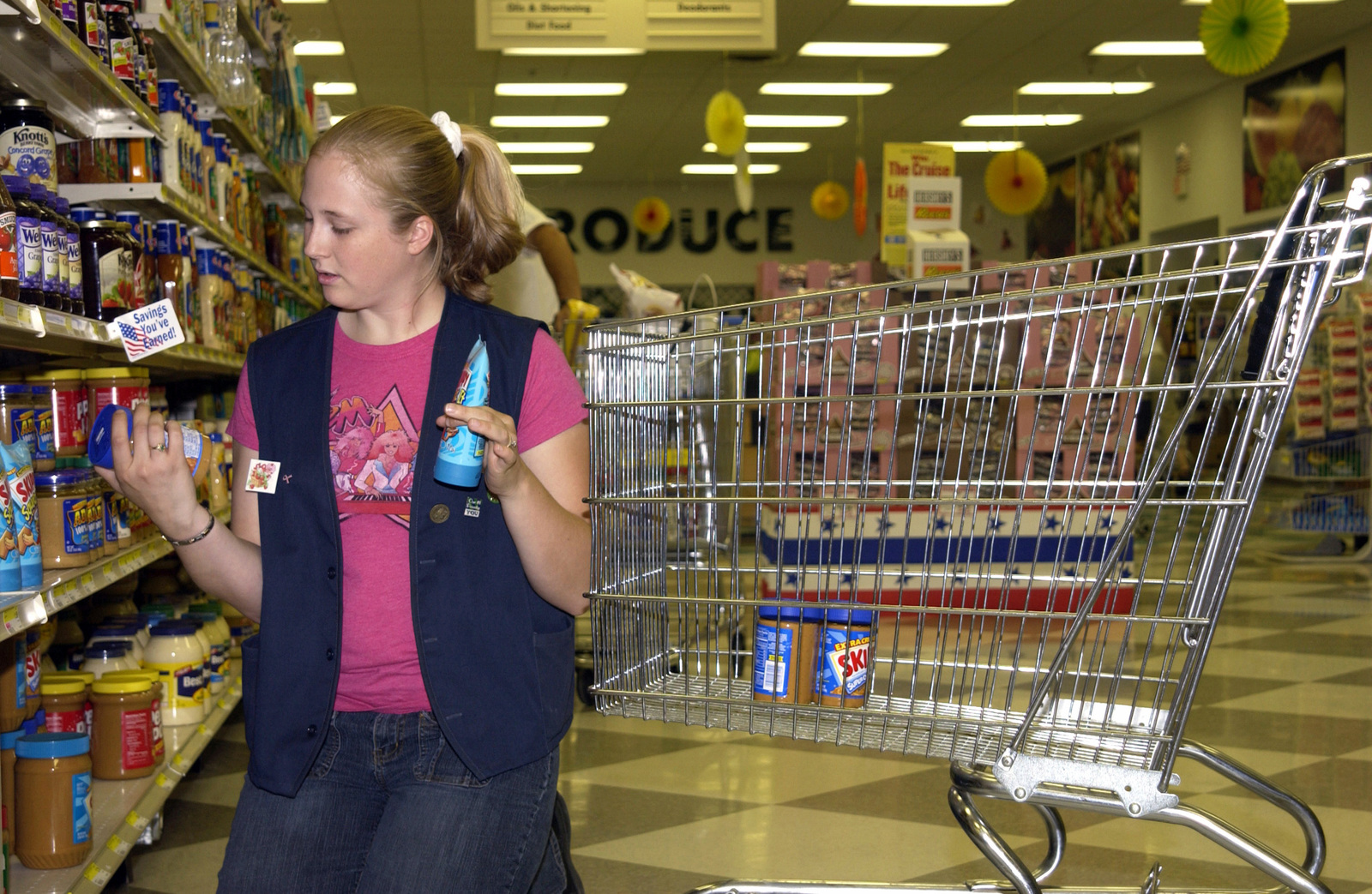 Stephanie Abbey Resets The Shelves In The Commissary At