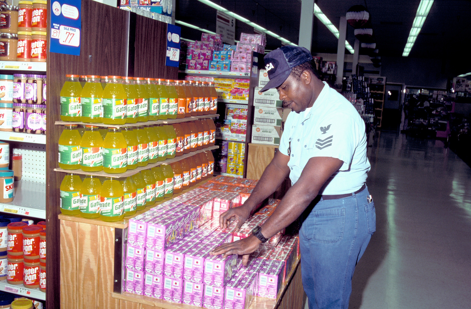 Ship's Serviceman Irby Stocks Shelves In The Base Commissary