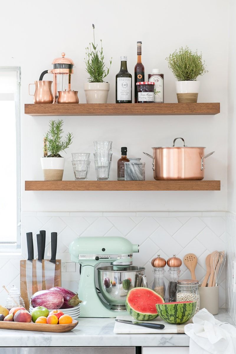 Kitchen Counter With Fruit Beneath Wooden Wall Shelves | Kitchen