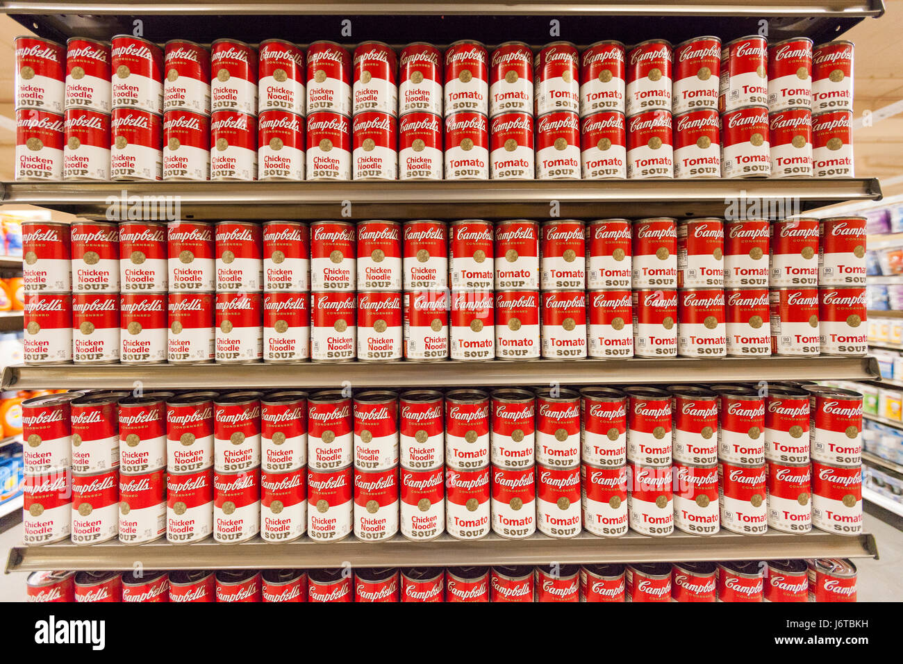 A Display Of Cambells Tomato Soup Cans On Display On Shelves