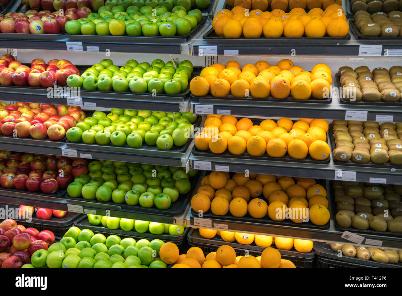 Fresh Healthy Fruits On Shelves In Supermarket Stock Photo