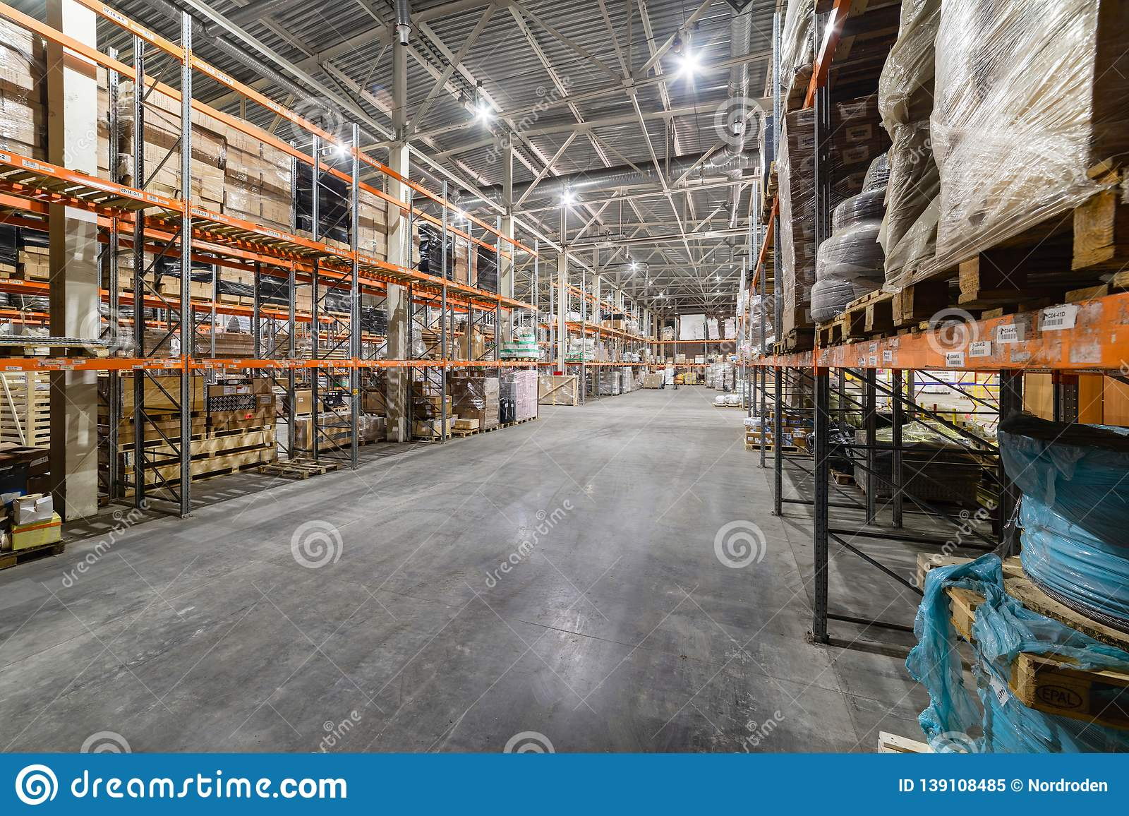 Long Shelves With A Variety Of Boxes And Containers Stock