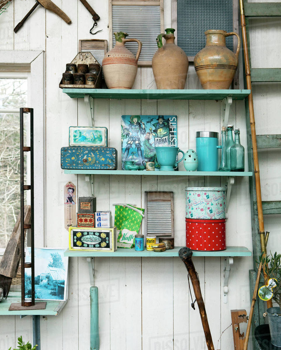 Containers And Vases On Wooden Shelves Stock Photo