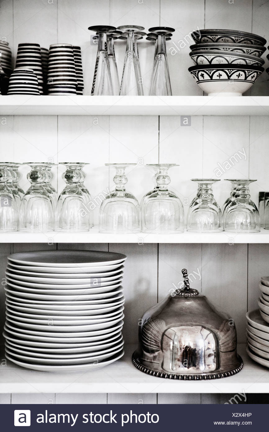 Shelves With Glasses, Plates And Bowls Stock Photo