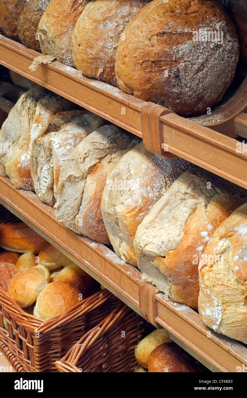 Shelves With Loaves Of Fresh Baked Bread On Display In