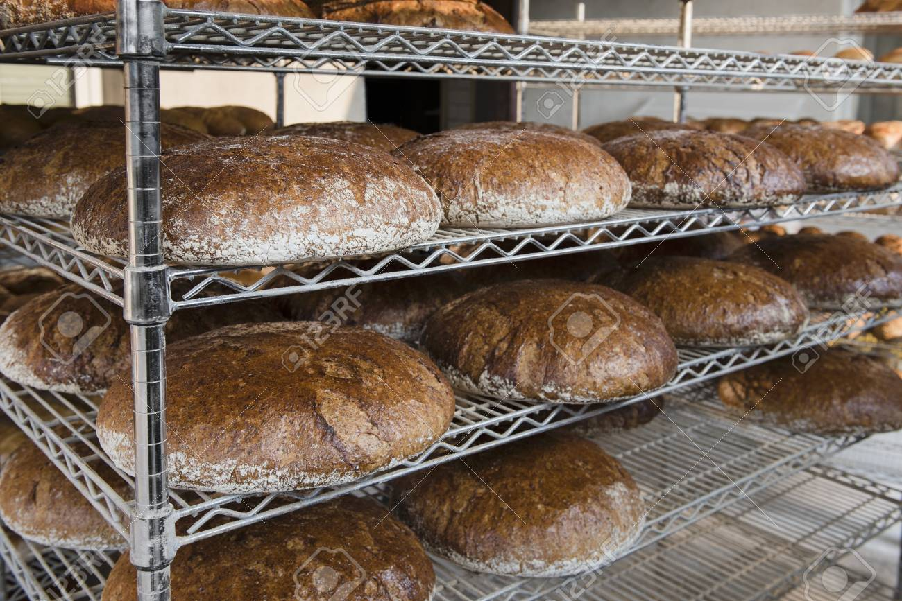 Loaves Of Graham Bread Baked In A Wood-fired Oven On Metal Shelves