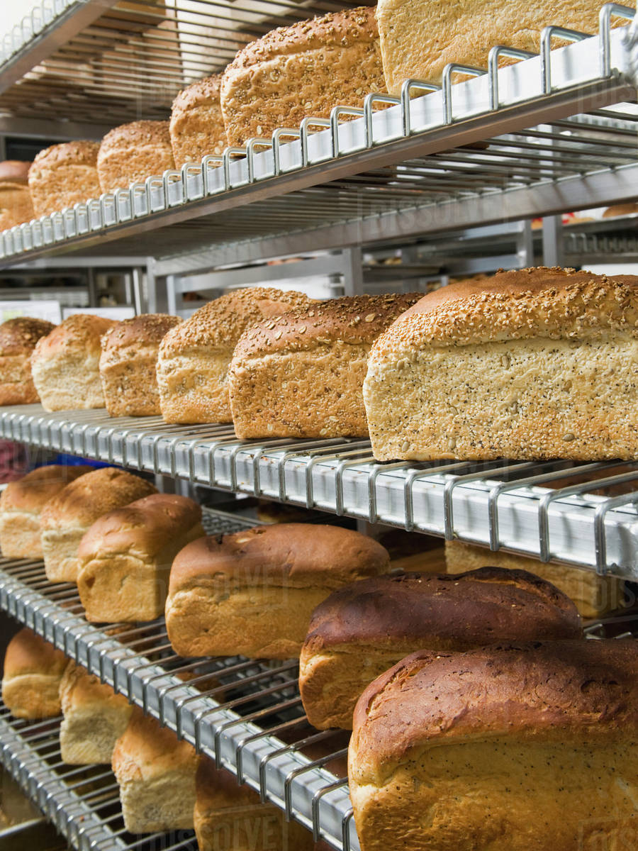 Loaves Of Bread On Shelves In Bakery Stock Photo