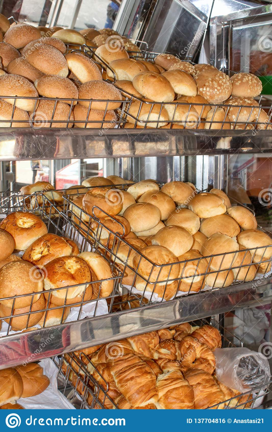 Freshly Baked Bread, Shelves With Buns On The Display Case