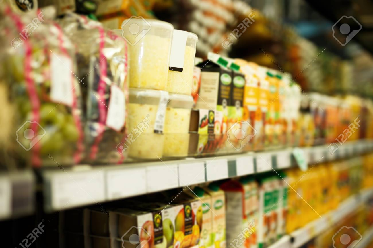 Image Of Shelves With Variety Grocery Products In The Supermarket