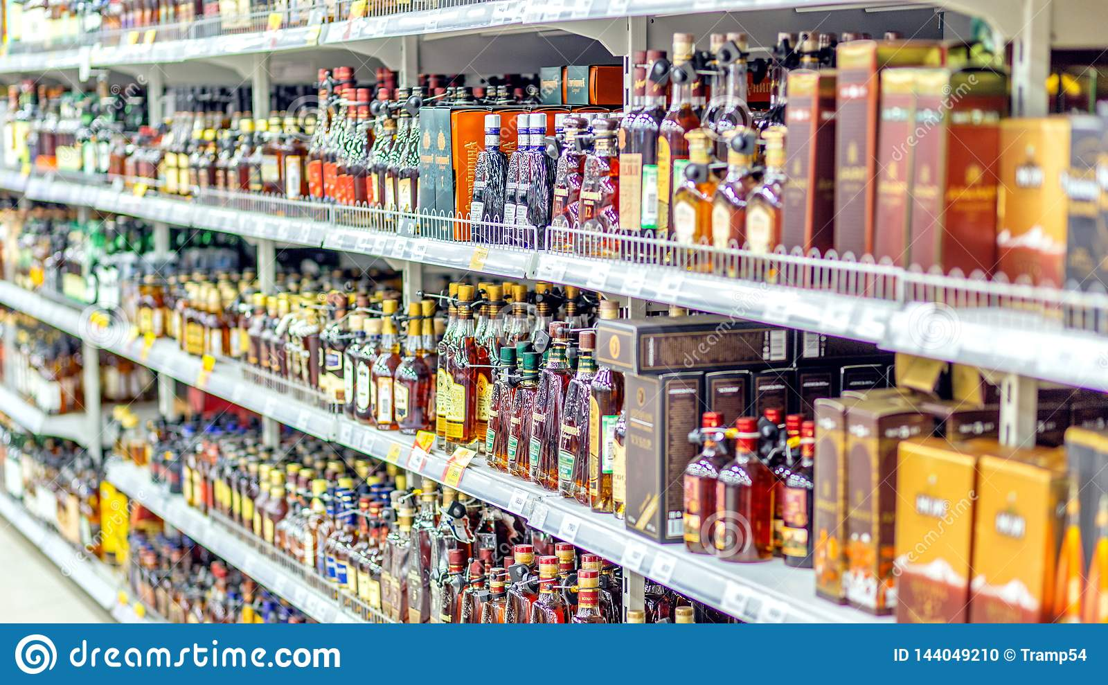 A Large Selection Of Alcoholic Beverages On The Shelves Of