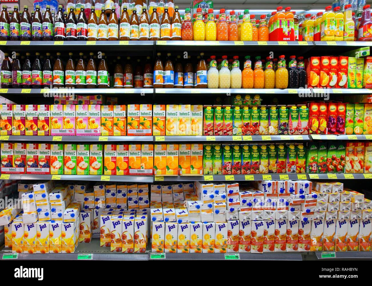 Shelves With Juice In Bottles And In Tetra Paks, Self