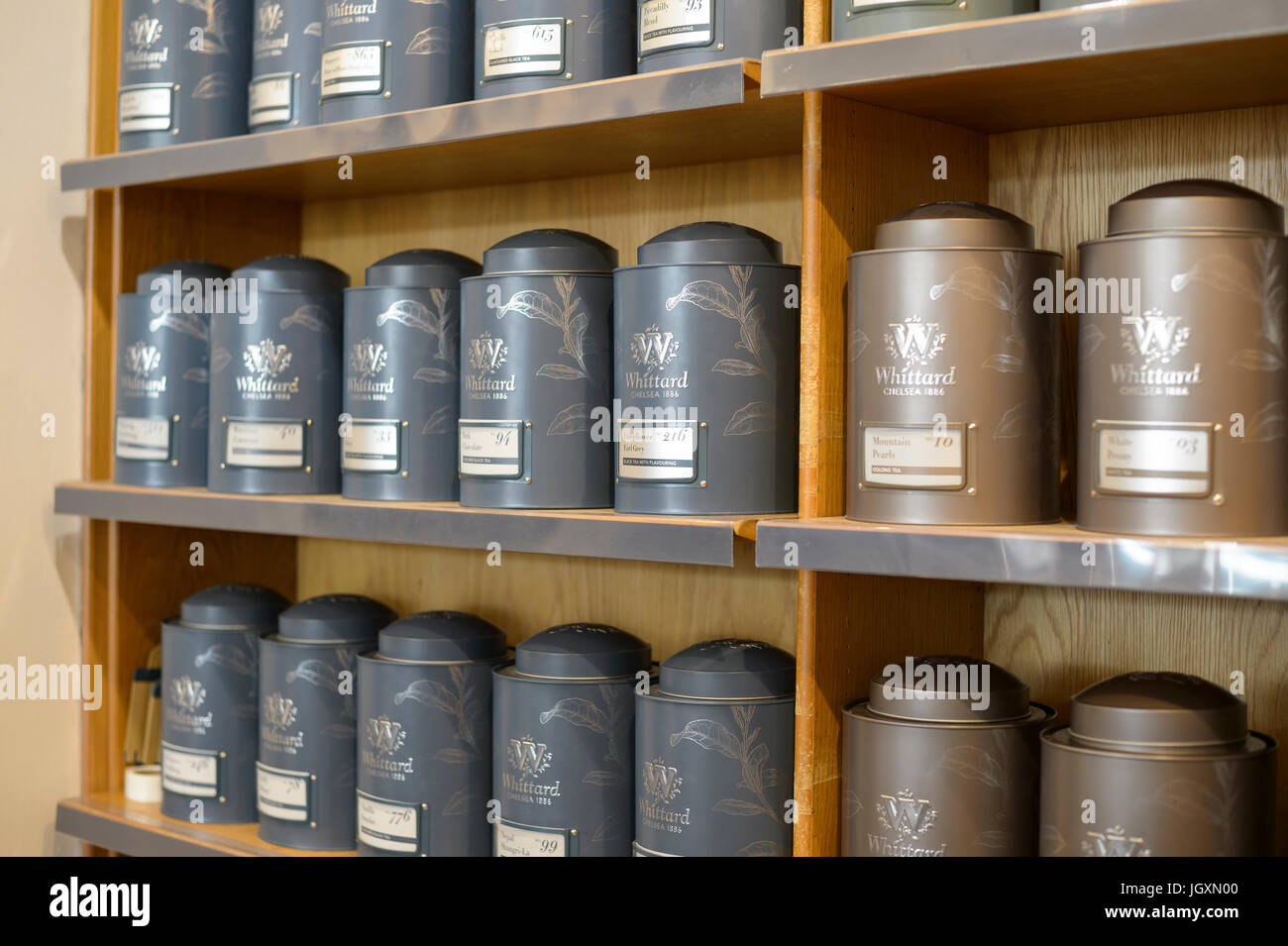 Cannisters Conatining Loose Leaf Tea On Shelves Shelving In