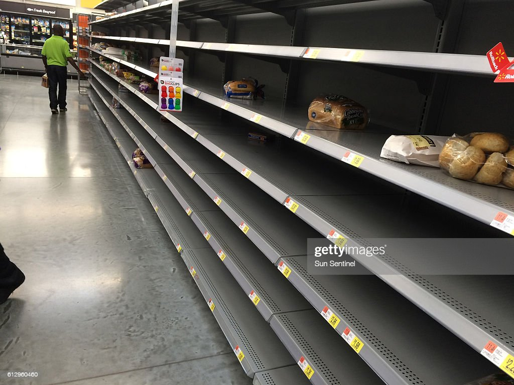 Shelves Usually Stocked With Bread And Bottled Water Were