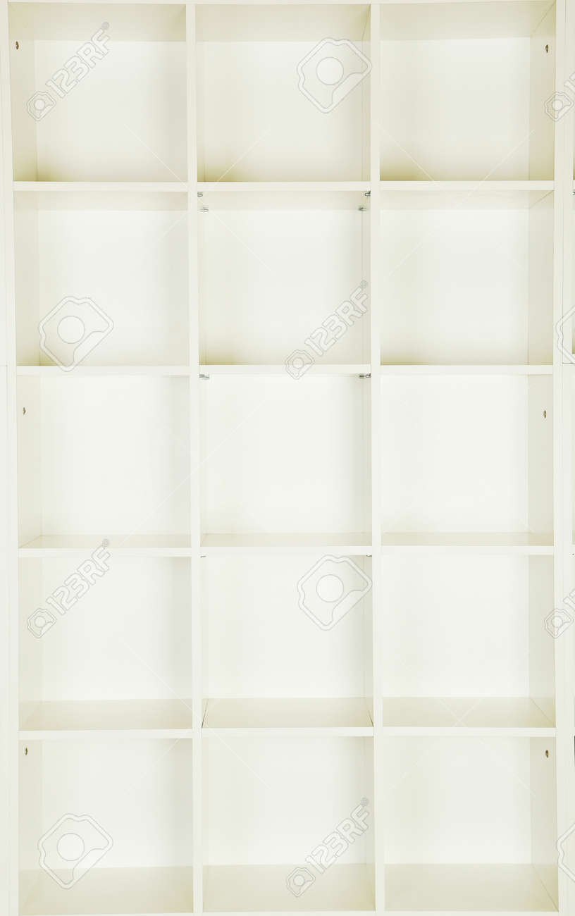Empty Shelves In White Wooden Rack, Close Up