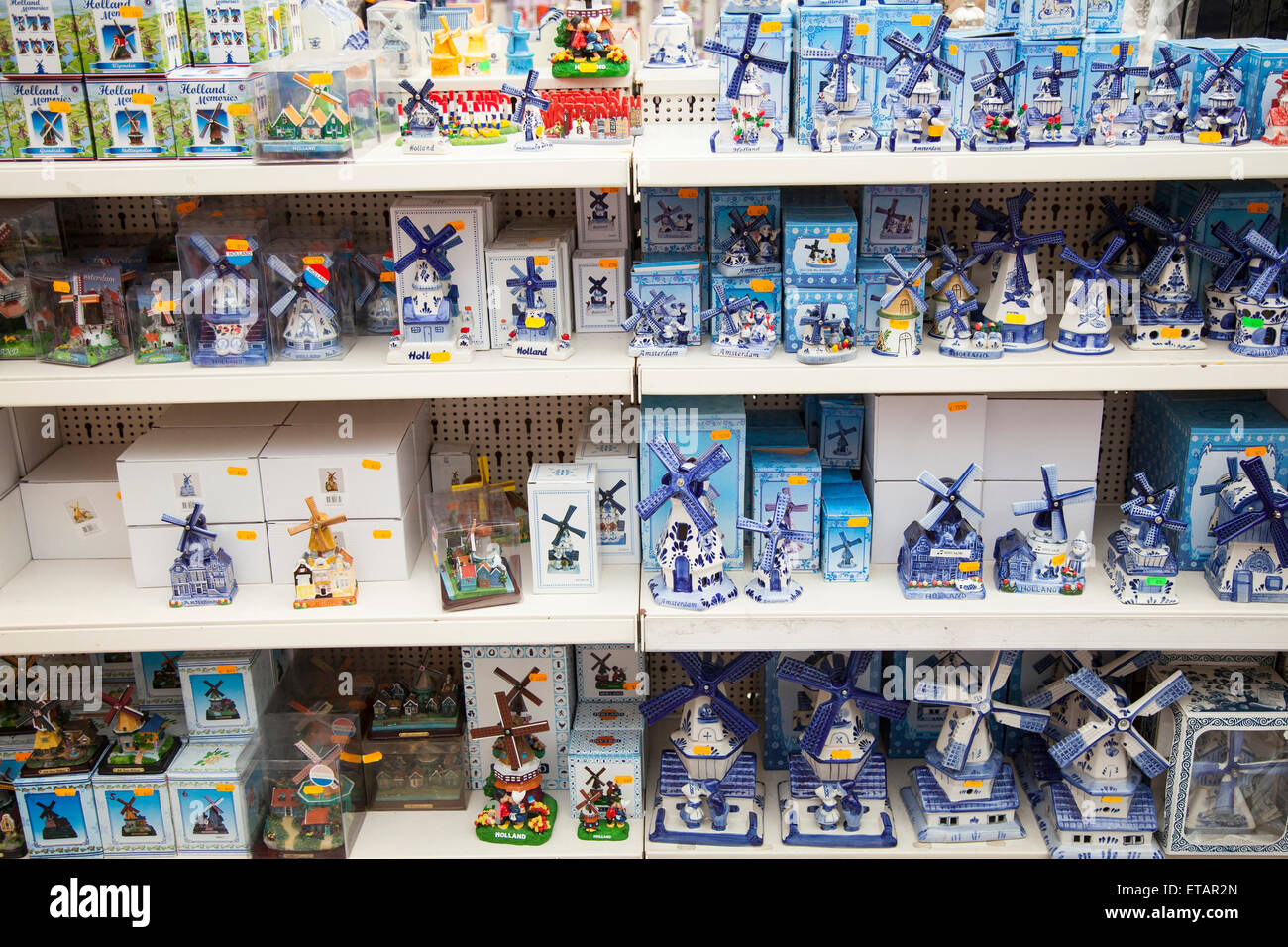Delft Blue Windmills And Other Souvenirs On Shelves In