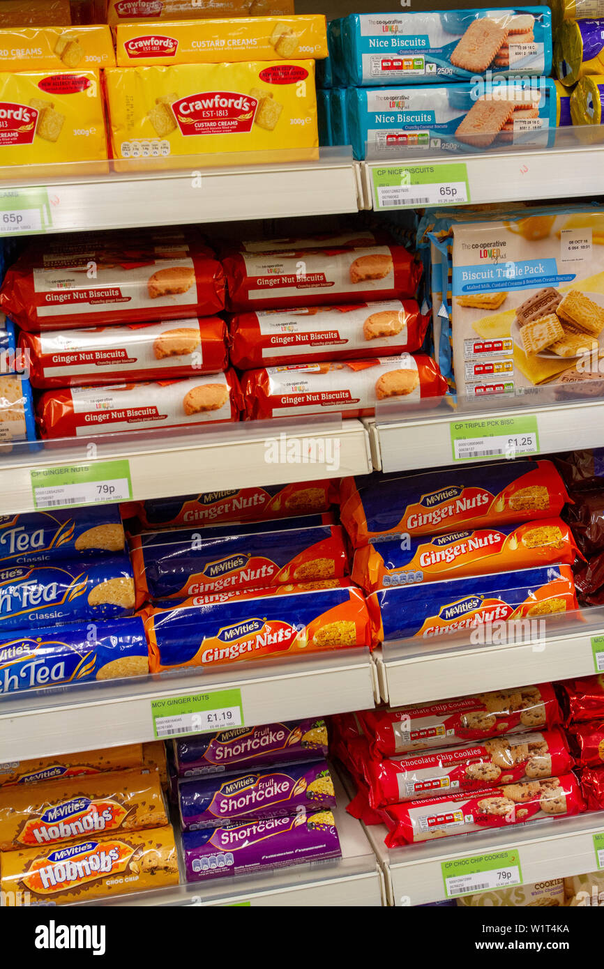 Packets Of Biscuits On A Co-op Supermarket's Shelves Stock