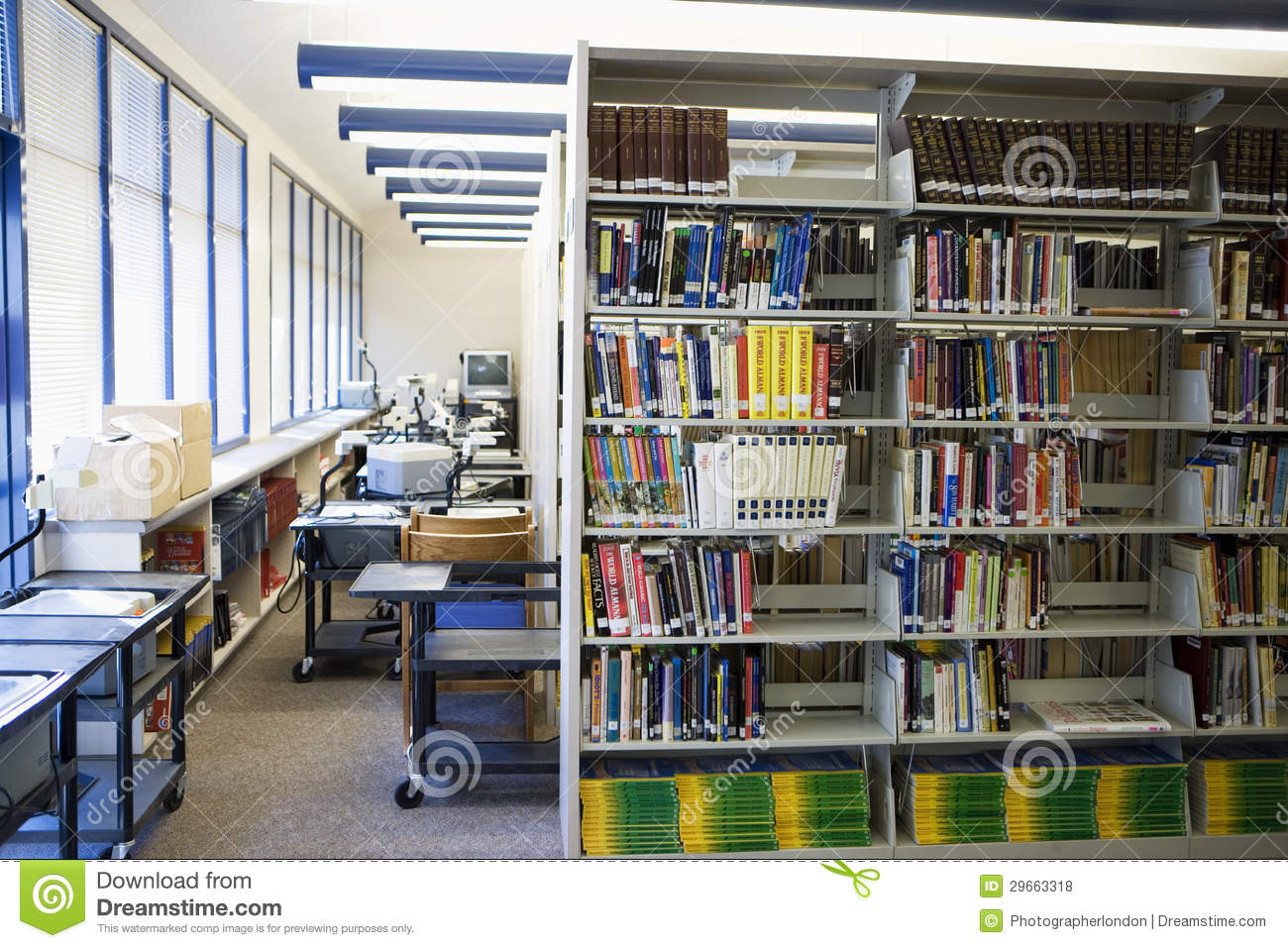 Book Arranged On Shelves In High School Library Stock Photo