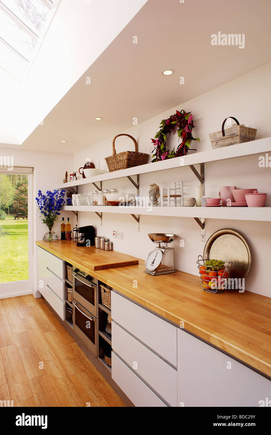 Wooden Worktop On Fitted White Unit Below Open White Shelves