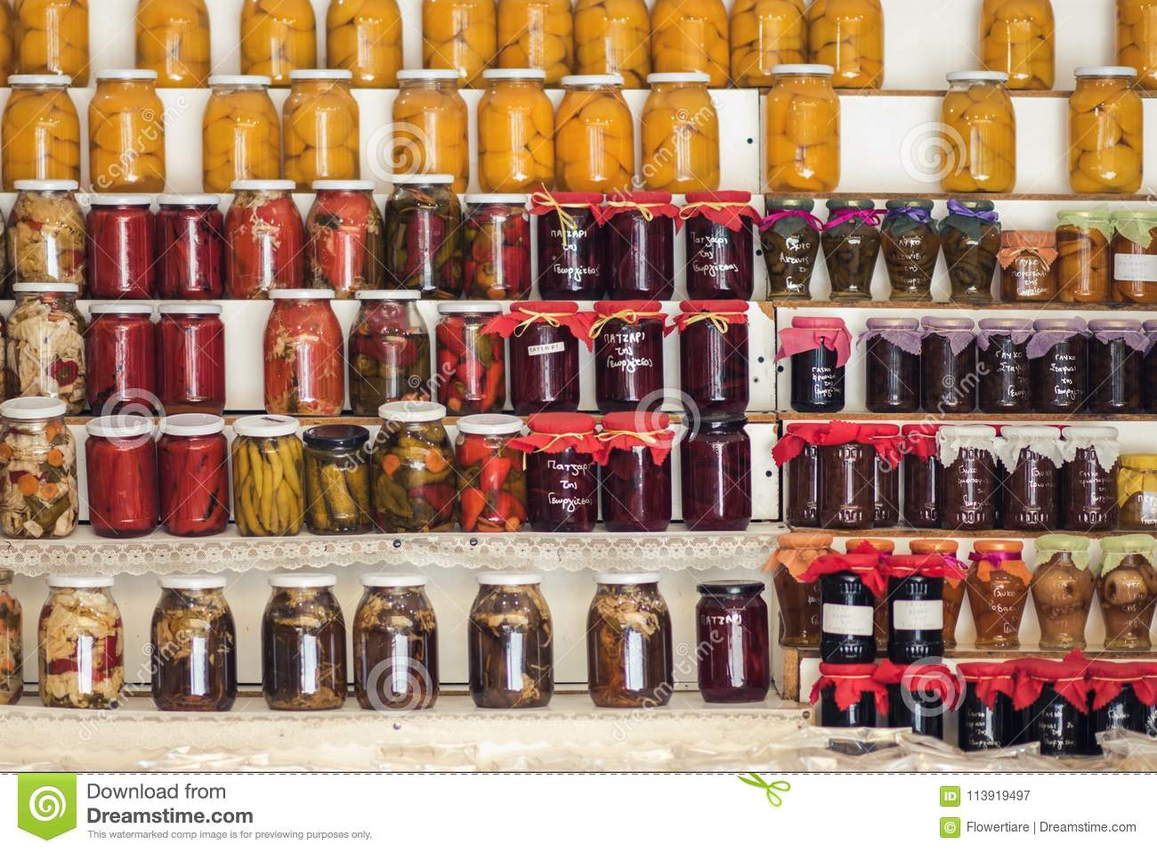 Greek Homemade Jam And Canned Food On The Shelves Of Local