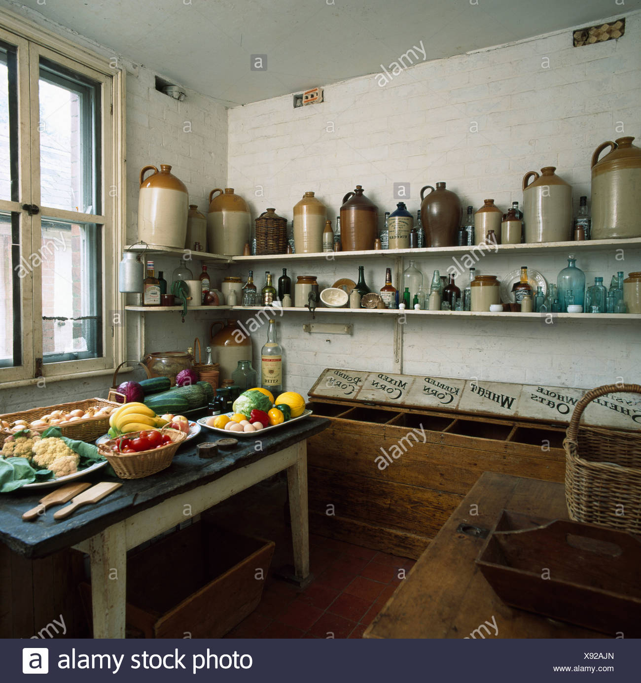 Earthenware Jars On Shelves In Old Fashioned Larder With