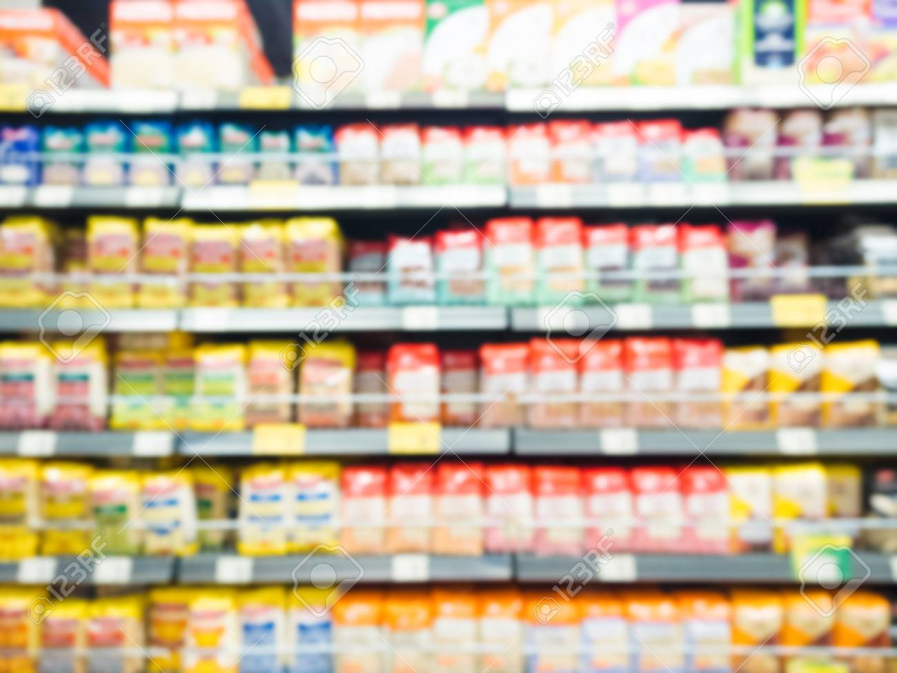Blurred Shelves With Cereals In Supermarket
