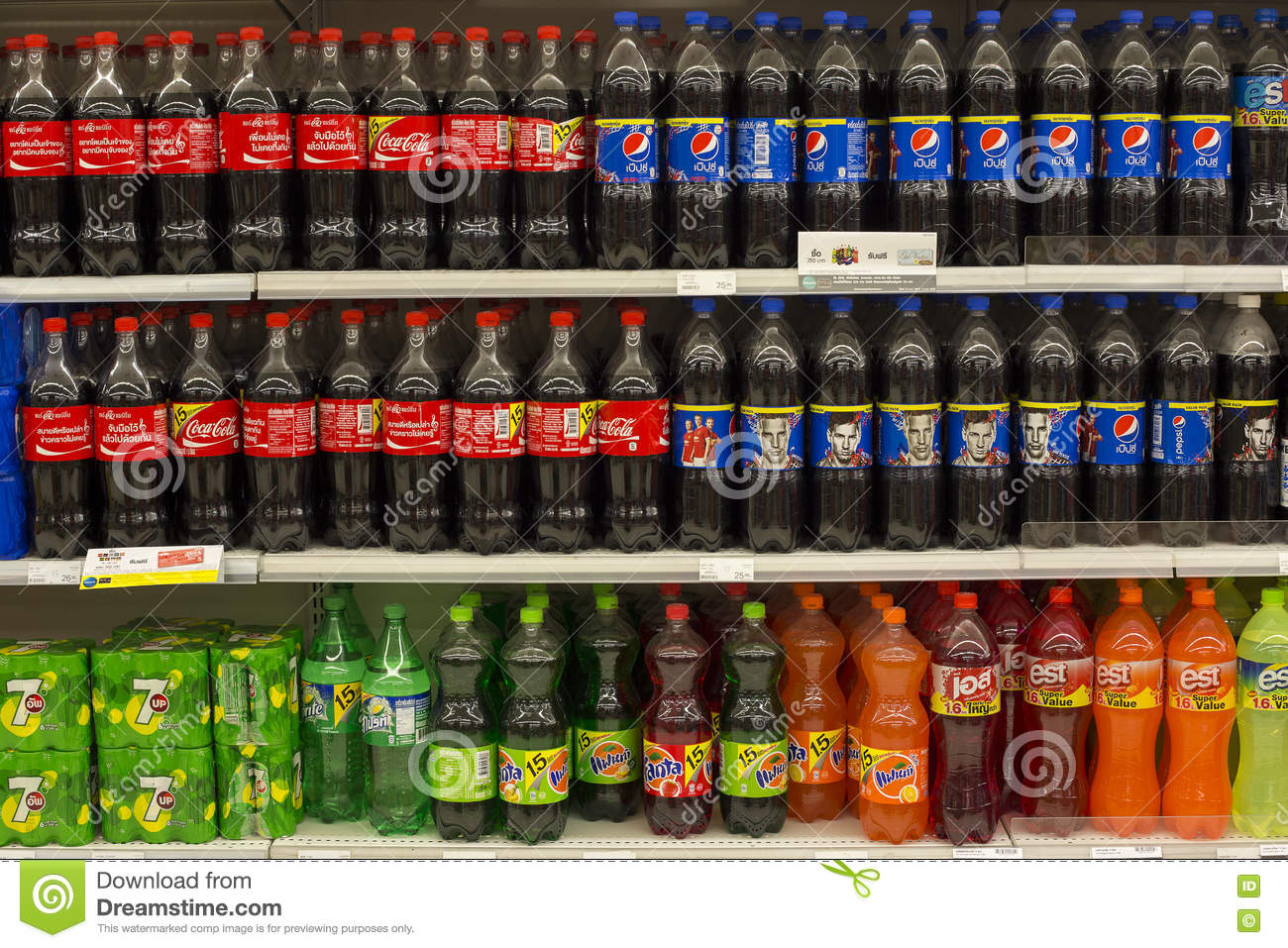 Shelves With Bottles Of Coca Cola, Pepsi Cola, Fanta And