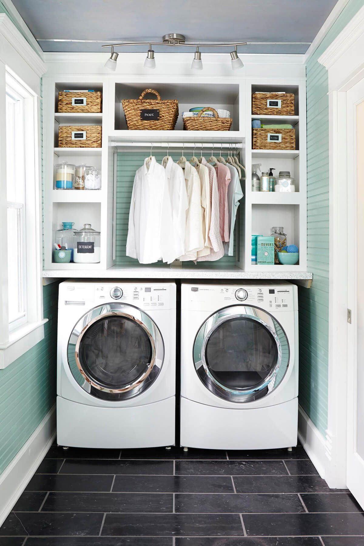 Custom Shelves And Hanging Space Maximize This Laundry Nook