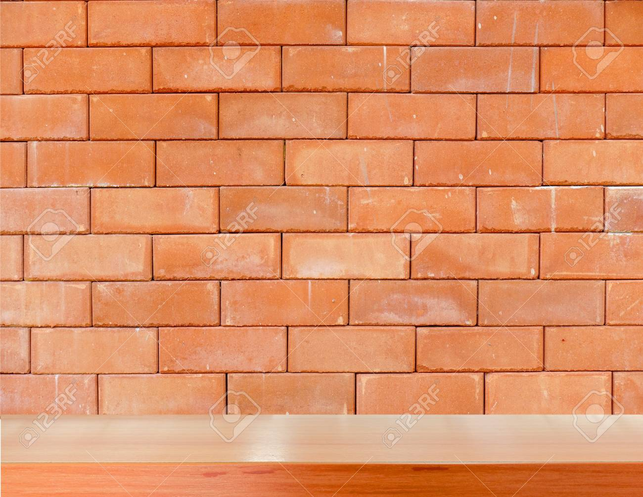 Wooden Shelves On Red Brick Background